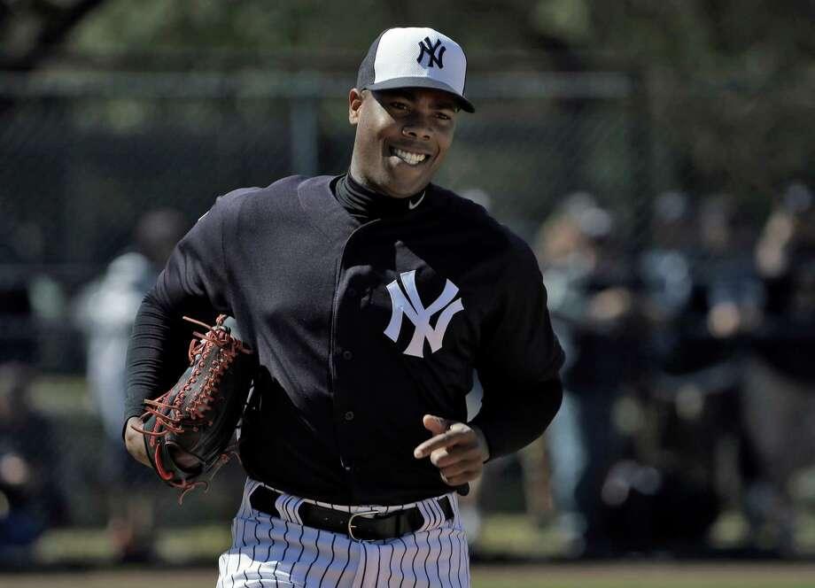 New York Yankees pitcher Aroldis Chapman smiles as he runs pickoff drills during a spring training baseball workout Friday, Feb. 19, 2016, in Tampa, Fla. (AP Photo/Chris O'Meara)  ORG XMIT: FLCO116 Photo: Chris O'Meara / AP