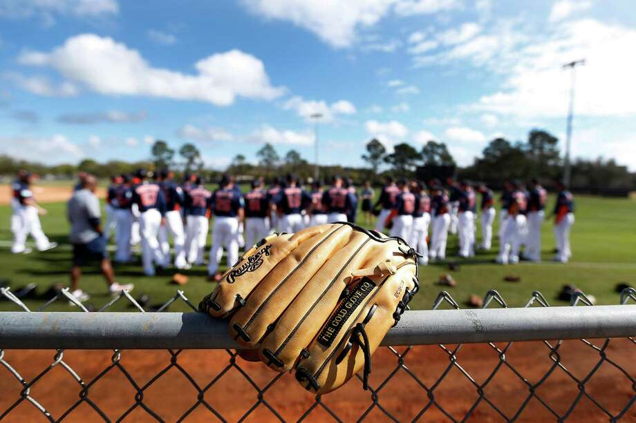 A glove sits atop a fence as players warm up during the first full-squad workouts at the Astros spring training in Kissimmee, Florida, Tuesday, Feb. 23, 2016.( Karen Warren / Houston Chronicle ) Photo: Karen Warren, Staff / © 2015  Houston Chronicle