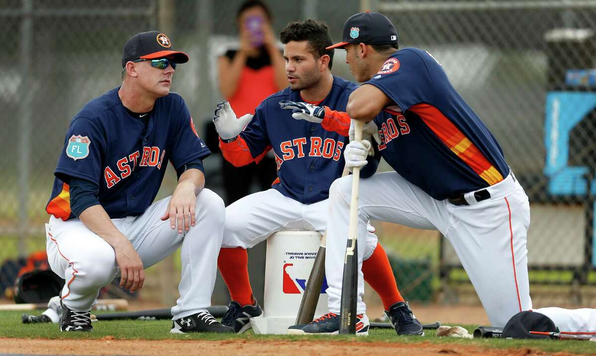 On the day of the first full Astros workout, second-year manager A.J. Hinch, left, could relax a little bit, knowing he has two formidable middle infielders in All-Star second baseman Jose Altuve, center, and Rookie of the Year shortstop Carlos Correa.