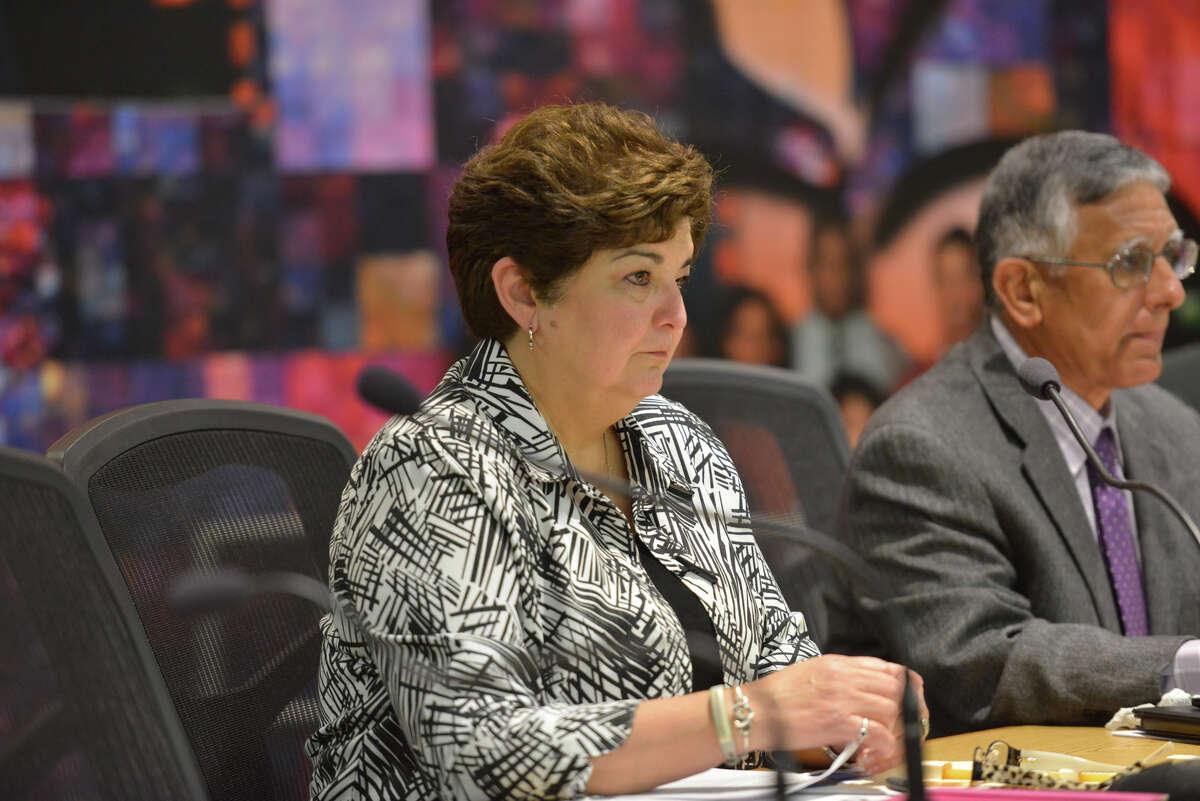 SAISD Trustee Olga Hernandez listens to advocates for a living wage for district staff speak to the board recently.