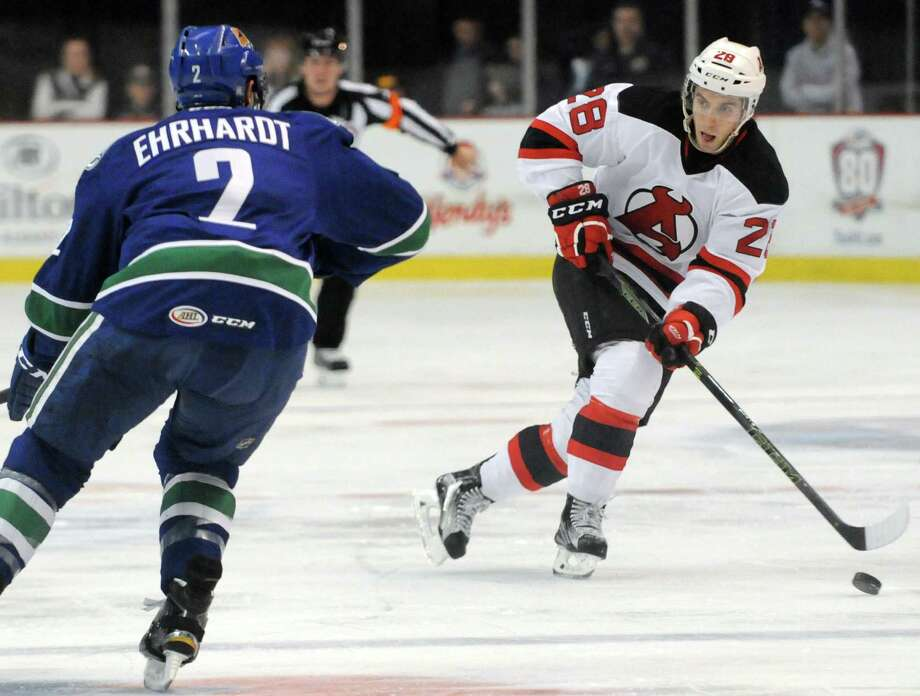 Devils Matt Lorito brings the puck up the ice during their hockey game against Utica at the Times Union Center on Wednesday Dec. 30, 2015 in Albany, N.Y.  (Michael P. Farrell/Times Union) Photo: Michael P. Farrell / 00033949K