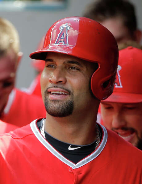 Los Angeles Angels' Albert Pujols stands in the dugout during a baseball game against the Seattle Mariners, Sunday, July 12, 2015, in Seattle. (AP Photo/Ted S. Warren) Photo: Ted S. Warren, STF / AP
