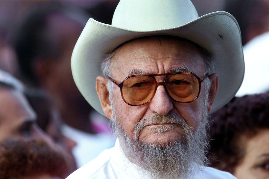 FILE - This Dec. 22, 2001 file photo shows Ramon Castro during a rally, in Havana, Cuba. Castro, a lifelong rancher and farmer who bore a strong physical resemblance to his younger brother, Cuban revolutionary leader Fidel Castro, died Tuesday, Feb. 23, 2016, state media announced. He was 91. ( AP Photo/Jose Goitia, File) ORG XMIT: XLAT136 Photo: JOSE GOITIA / AP