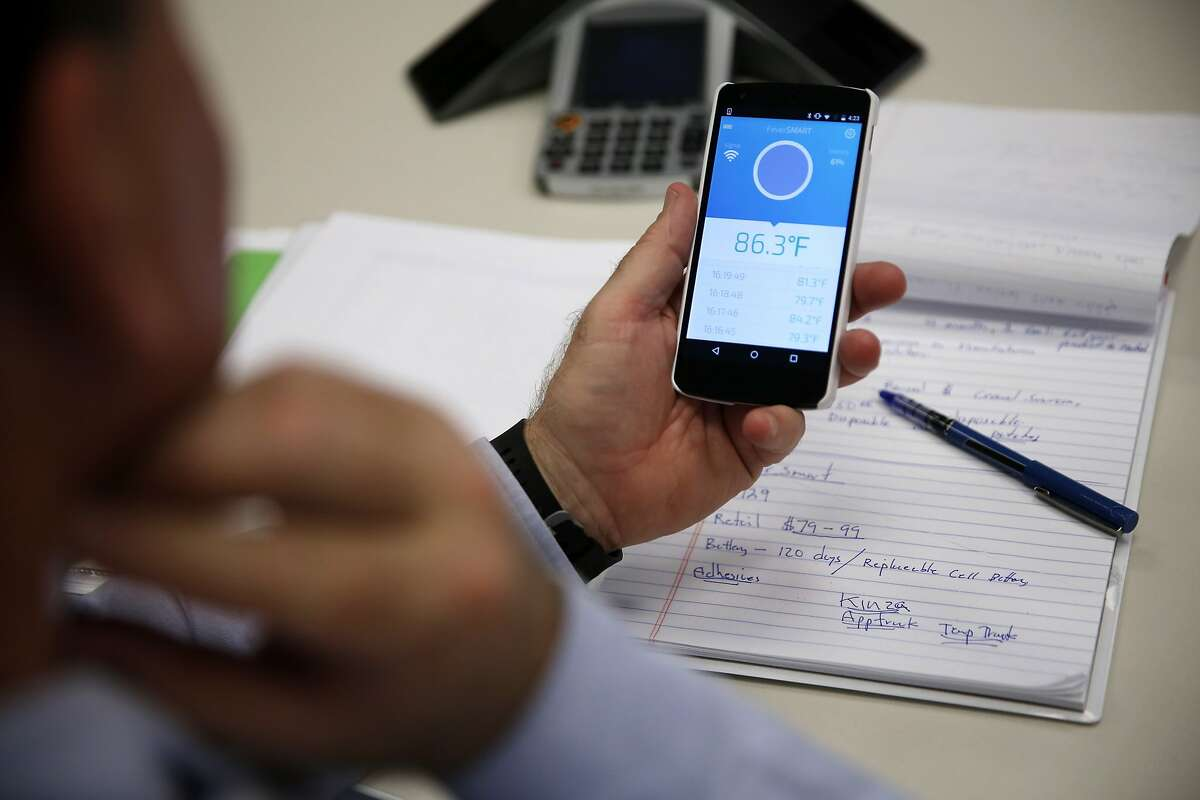 An audience member tests the Fever Smart patch and app during a product demonstration at Target offices in San Francisco, California, on Tuesday, Feb. 23, 2016.