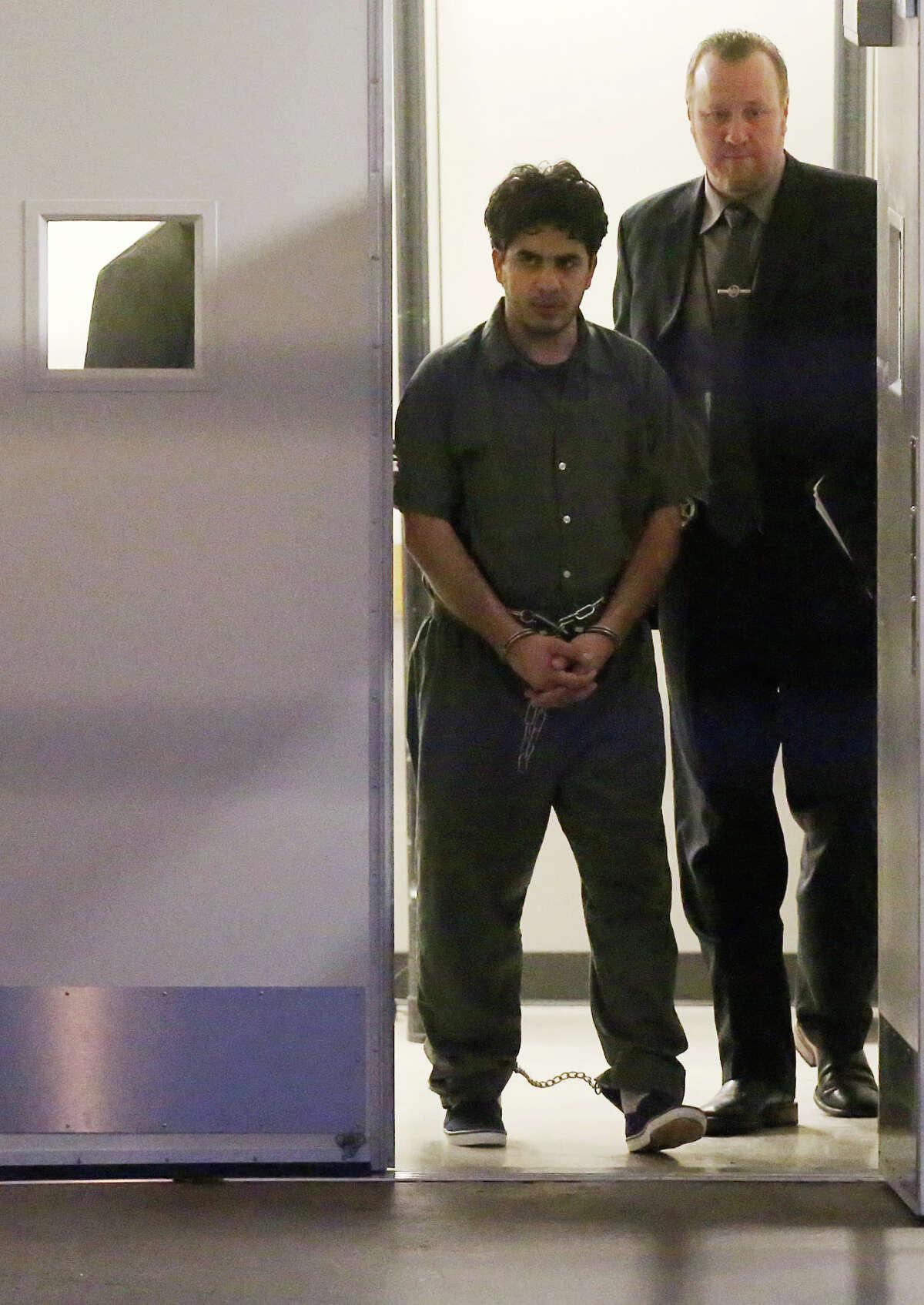 Omar Faraj Saeed Al Hardan is escorted out of the Bob Casey United States Courthouse by U.S. Marshalls Wednesday, Jan. 13, 2016, in Houston. ( Jon Shapley / Houston Chronicle )