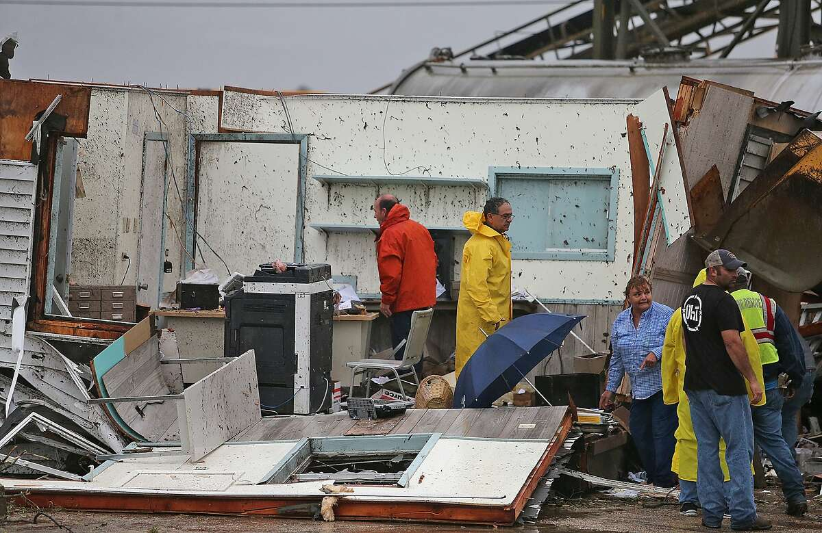 People search a destroyed trailer at a business near the intersection of Routes 70 and 1 Tuesday, Feb. 23, 2016, in Paincourtville, La. A suspected tornado ripped through a Louisiana recreational vehicle park Tuesday, leaving a mangled mess of smashed trailers and killing at least one person, officials said. In neighboring Mississippi, authorities said one person died when a possible tornado hit a mobile home. (Michael DeMocker/NOLA.com The Times-Picayune via AP) MAGS OUT; NO SALES; USA TODAY OUT; THE BATON ROUGE ADVOCATE OUT; THE NEW ORLEANS ADVOCATE OUT; MANDATORY CREDIT