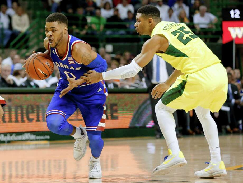 Kansas guard Frank Mason III (0) drives past Baylor's Al Freeman (25) to the basket in the first half of an NCAA college basketball game, Tuesday, Feb. 23, 2016, in Waco, Texas. (AP Photo/Tony Gutierrez) ORG XMIT: TXTG101 Photo: Tony Gutierrez / AP