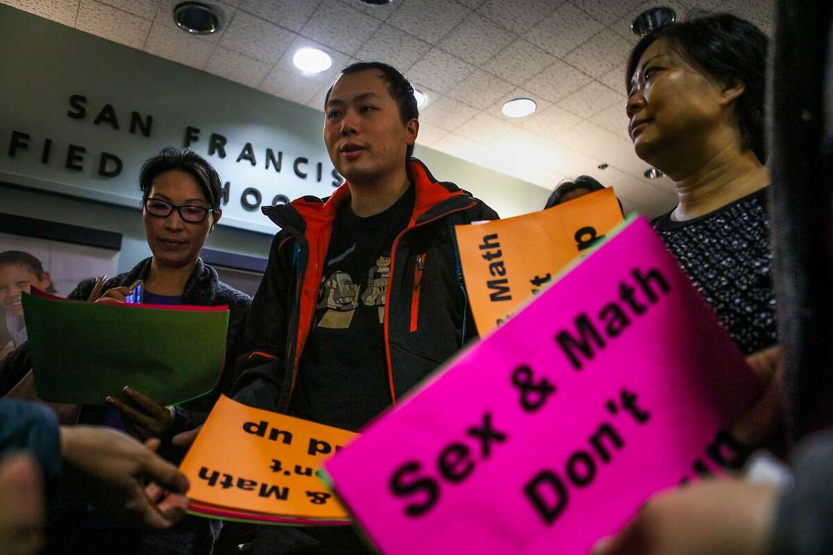 (l-r) Joanne Yow, Chong Liang Guo, and Tina Chan chat before they enter an S.F school board meeting where they will protest the ability of middle schoolers to obtain condoms at school, in San Francisco, California on Tuesday, February 23, 2016.