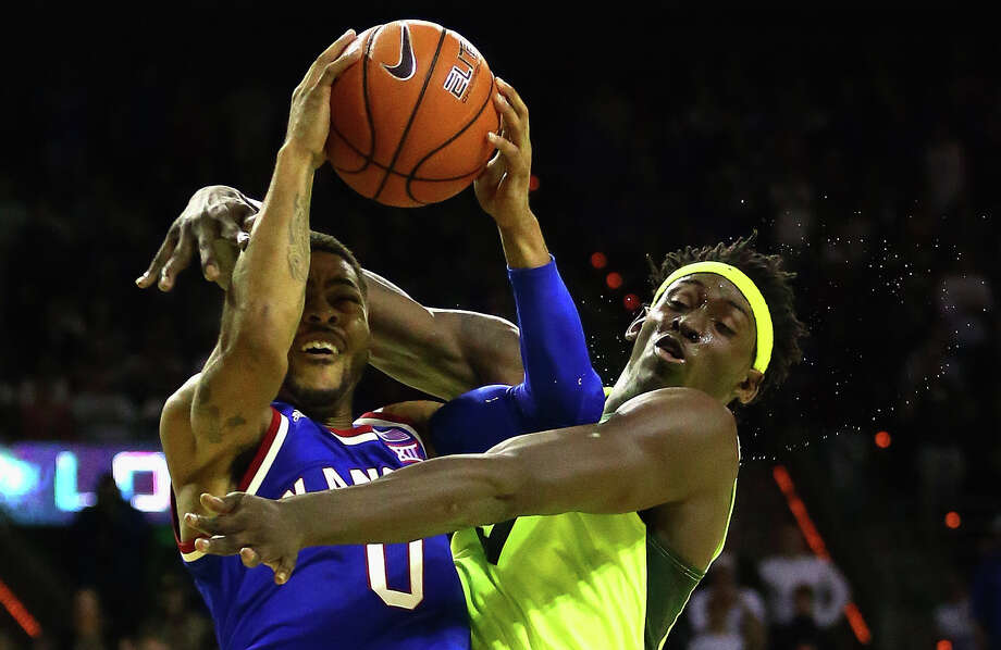 Baylor's Johnathan Motley commits a hard foul that leaves Kansas' Frank Mason III briefly hurting. Photo: Ronald Martinez, Staff / 2016 Getty Images
