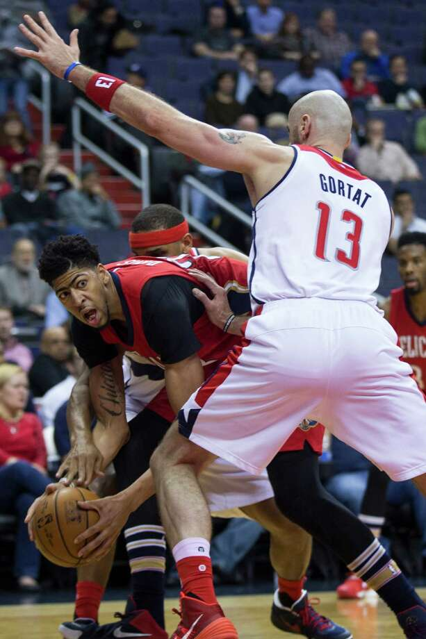 Washington Wizards center Marcin Gortat (13) defends against New Orleans Pelicans forward Anthony Davis (23) during the first half of an NBA basketball game, on Tuesday, Feb. 23, 2016, in Washington. (AP Photo/Evan Vucci) ORG XMIT: VZN104 Photo: Evan Vucci / AP