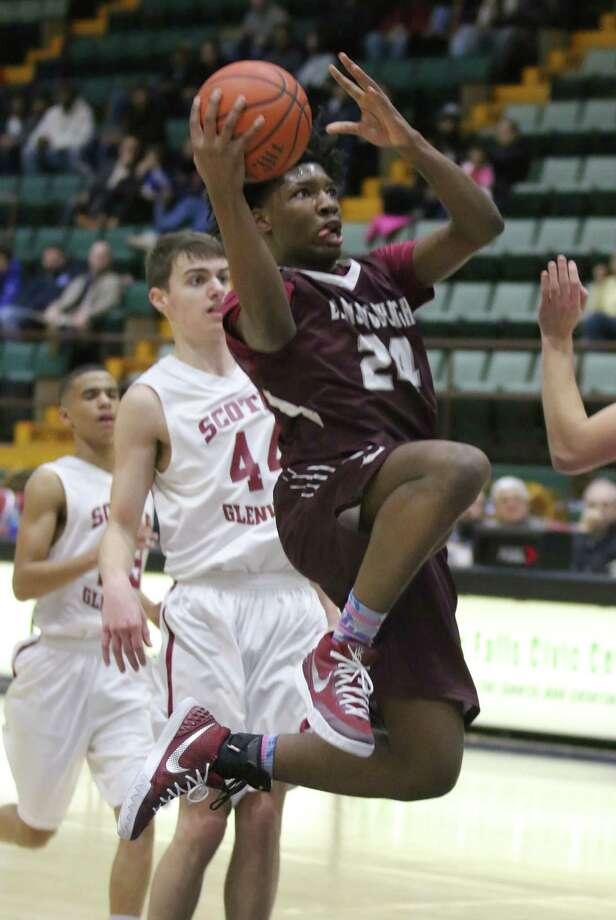 Lansingburgh's Jahidi Wallace switches hands as as goes up for a shot against Scotia-Glenville during Tuesday's Section II Class A semifinals at the Glens Falls Civic Center February 23, 2016. (Ed Burke/Special to The Times Union)