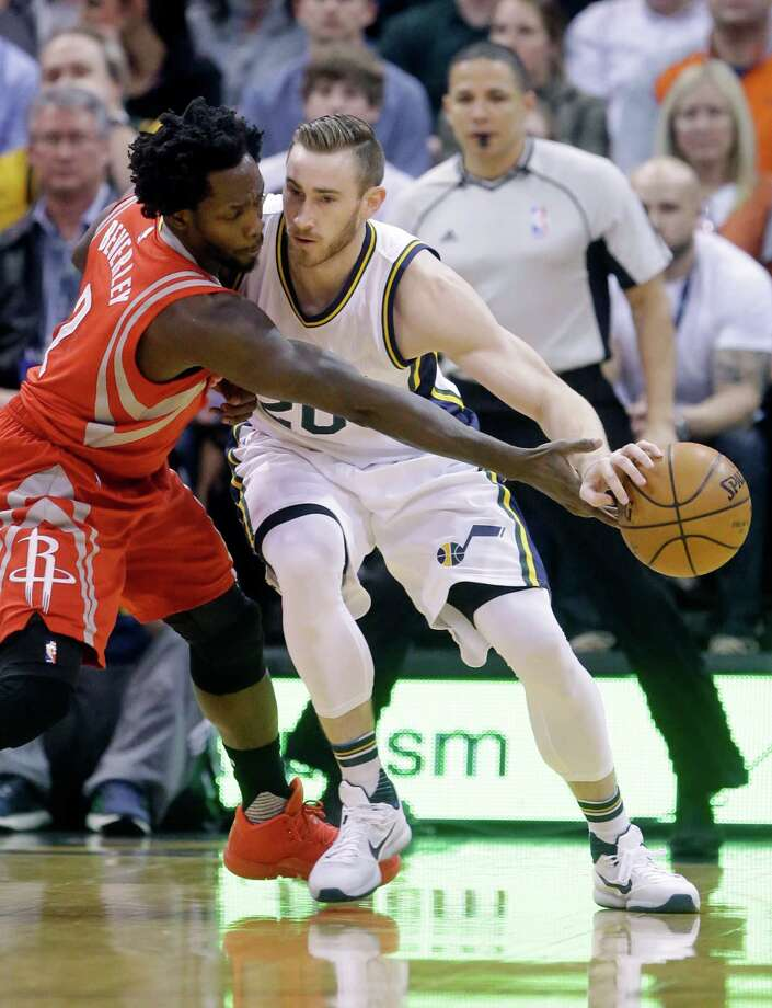 The Rockets' Pat Beverley, left, gives Jazz forward Gordon Hayward a dose of tight defense. Photo: Rick Bowmer, STF / AP