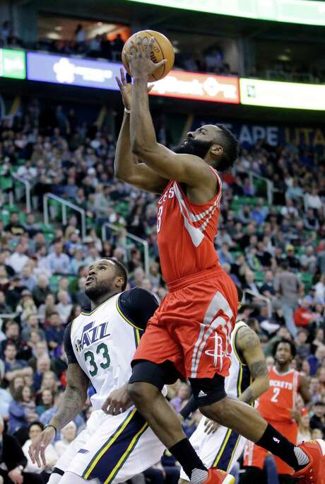 James Harden, right soared to 42 points for his eighth 40-plus game of the season. Photo: Rick Bowmer, STF / AP