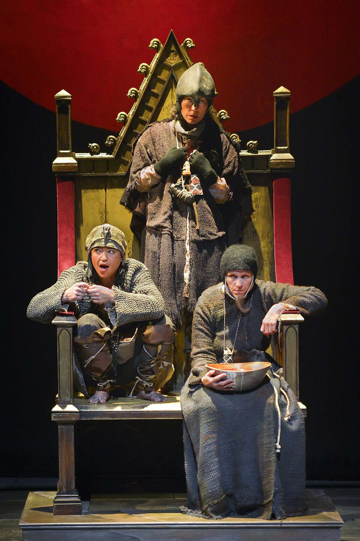 The Witches (Rami Margron, left, Mia Tagano and Frances McDormand) occupy the throne of Scotland in