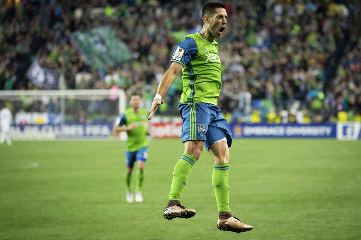 Seattle Sounders' Clint Dempsey leaps into the air after scoring a goal on a penalty kick during a CONCACAF Champions League quarterfinals match against Club America of Mexico City at CenturyLink Field in Seattle on Tuesday, Feb. 23, 2016.