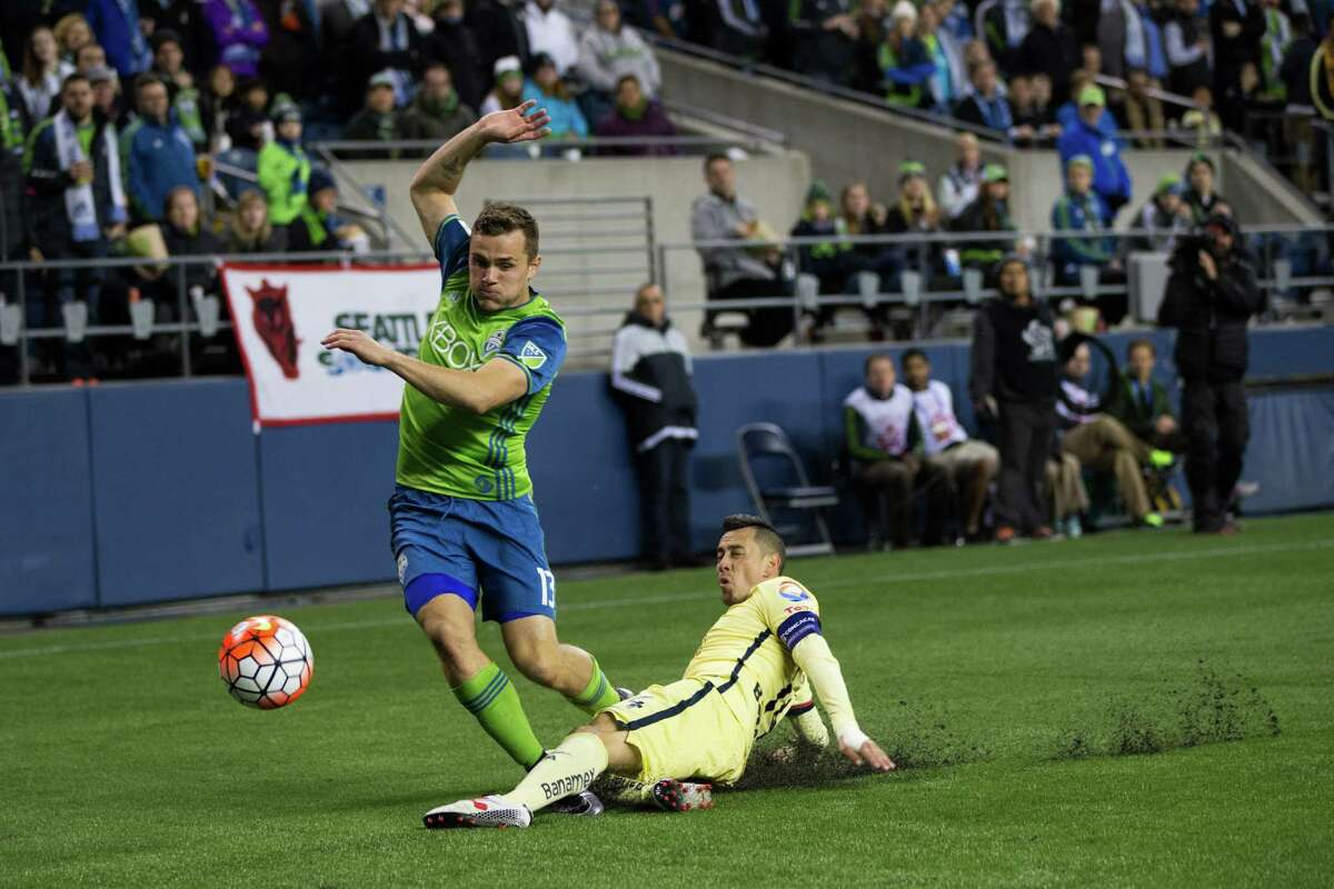 Seattle Sounders' Jordan Morris trips over Club America's Rubens Sambueza during a CONCACAF Champions League quarterfinals match at CenturyLink Field in Seattle on Tuesday, Feb. 23, 2016.