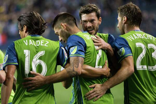 Seattle Sounders' celebrate Clint Dempsey's penalty kick goal during a CONCACAF Champions League quarterfinals match against Club America of Mexico City at CenturyLink Field in Seattle on Tuesday, Feb. 23, 2016.