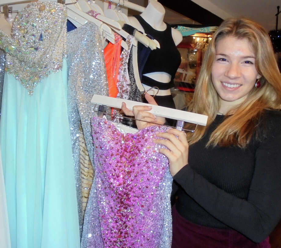 Staples High School Haley Burns shows off a sparkly silver and violet sequined dress that she wore only once, which prompted her to set up her Gown Around business that sells such lightly used gowns and dresses at discounted prices. Photo: Westport News / Meg Barone / Westport News