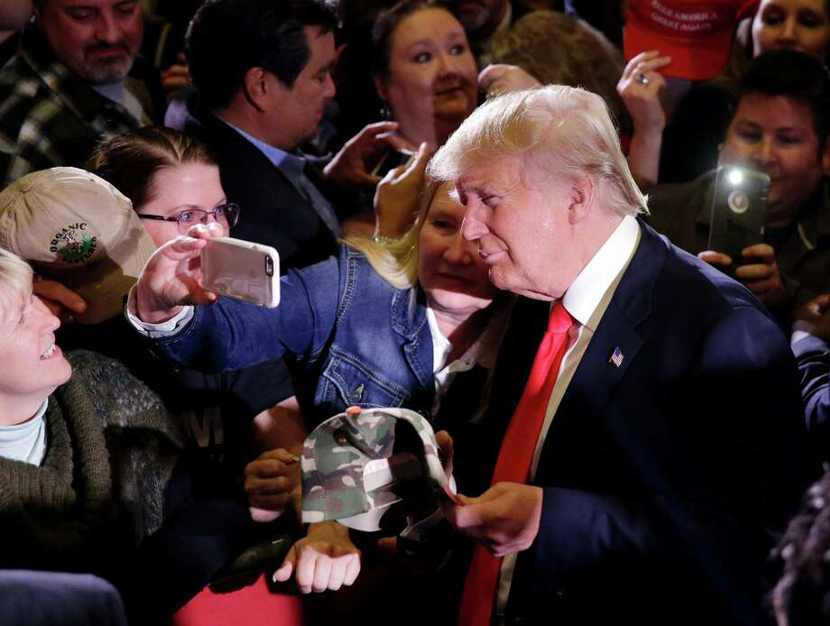 Republican presidential candidate Donald Trump takes pictures with supporters during a rally Tuesday, Feb. 23, 2016, in Reno, Nev. (AP Photo/Marcio Jose Sanchez) ORG XMIT: NVMS120 Photo: Marcio Jose Sanchez / AP