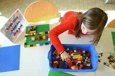 Avery Hanson, 7, of Darien, considers Lego options at Darien Library Saturday.