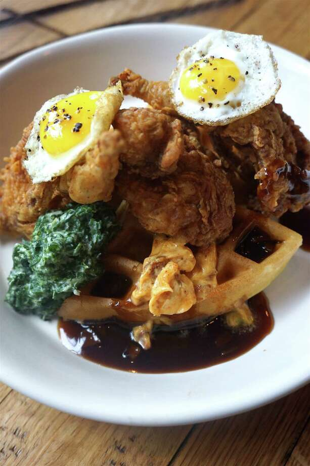 Fried quail with sweet potato waffle, fried quail egg, creamed mustard greens and sorghum-persimmon syrup at Holley's Seafood Restaurant & Oyster Bar which begins serving Sunday brunch on Feb. 28. Brunch will be every Sunday from 10 a.m. to 2 p.m. Photo: Katherine Ross