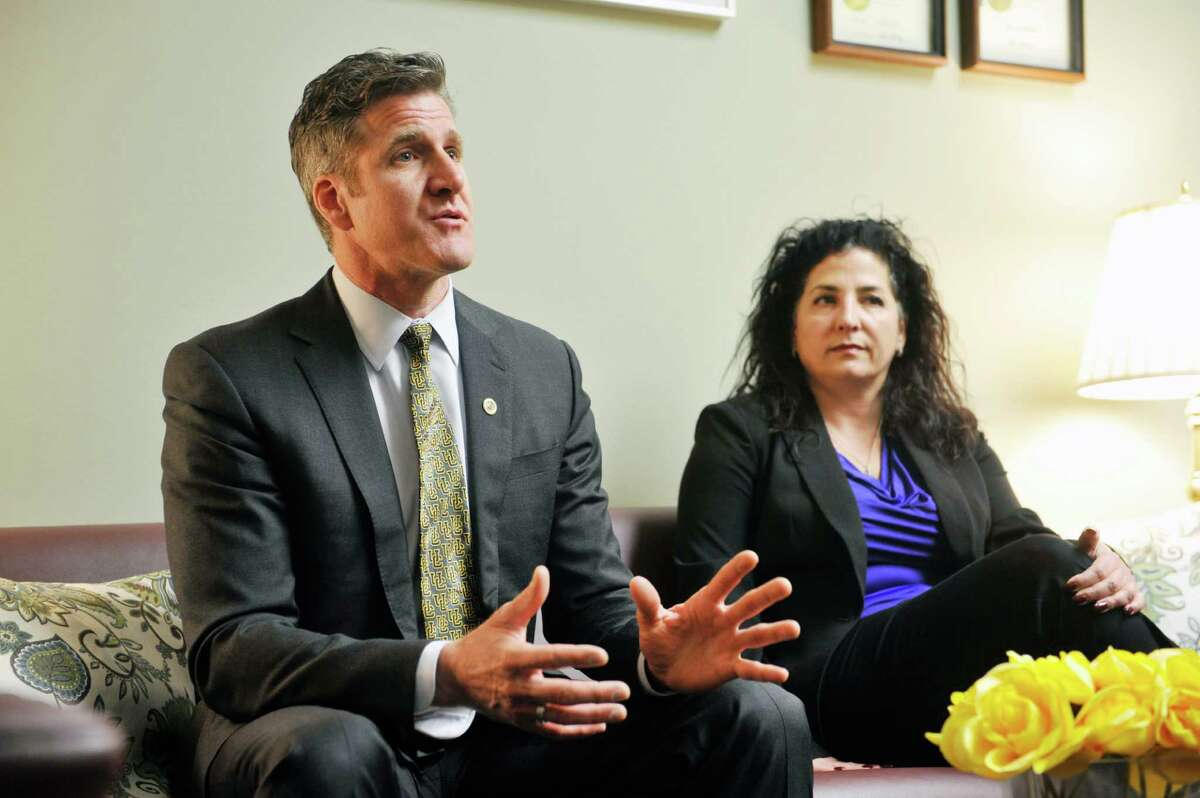 Dan Diaz, left, the widower of Brittany Maynard, and Senator Diane Savino talk in the Senator's office on Wednesday, Feb. 24, 2016, in Albany, N.Y. Diaz and Maynard moved to Oregon to take advantage of physician-assisted suicide laws there. Diaz is at the Capitol to advocate for similar legislation here in New York State. (Paul Buckowski / Times Union)