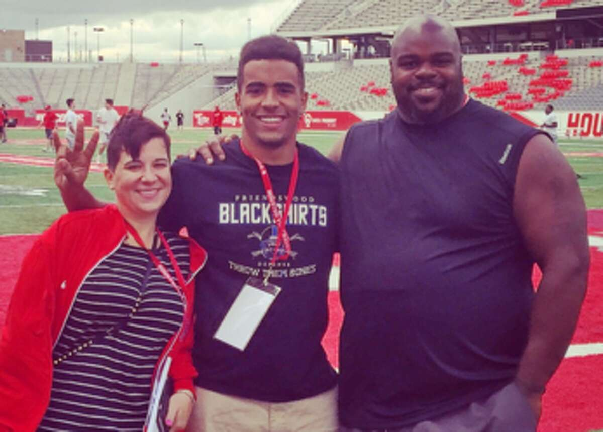 D'Aundre Holmes-Wilfork with his mother and father, Texans defensive tackle Vince Wilfork, in February 2016 after Holmes-Wilfork announced his transfer to UH as a preferred walk-on.