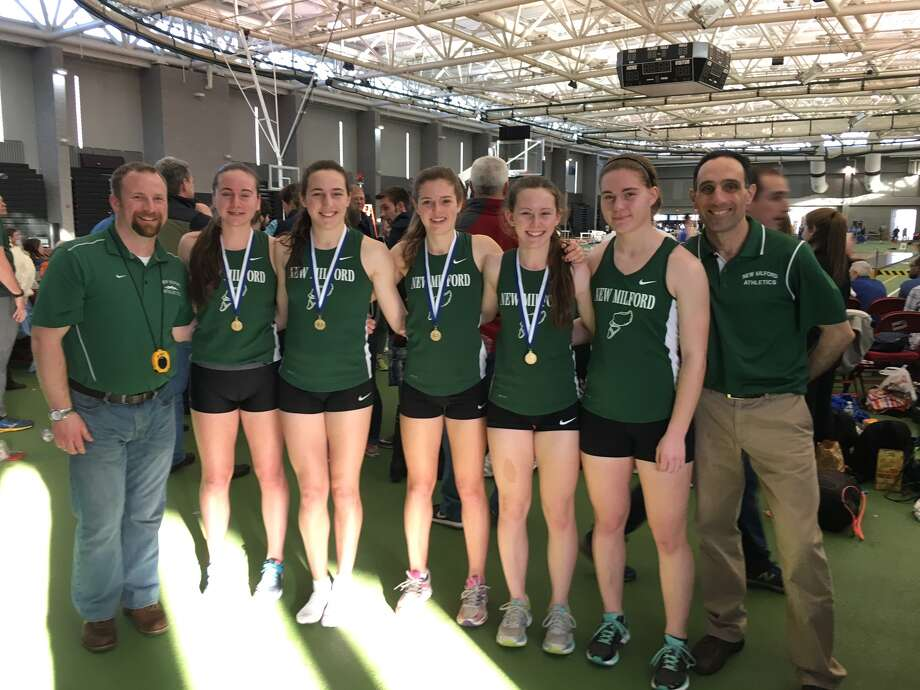 From left, Ryan Fitzsimmons, Brigit Humphreys, Mia Nahom, Hannah Tower, Riley Peragine, Raquel Morehouse and Mike Nahom are all smiles after a big day at the CIAC State Open. The team of Peragine, Humphreys, Nahom and Tower won the 4x800 relay championship. Photo: Photo Courtesy Of Ann Hartman