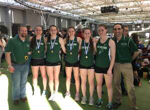 From left, Ryan Fitzsimmons, Brigit Humphreys, Mia Nahom, Hannah Tower, Riley Peragine, Raquel Morehouse and Mike Nahom are all smiles after a big day at the CIAC State Open. The team of Peragine, Humphreys, Nahom and Tower won the 4x800 relay championship.