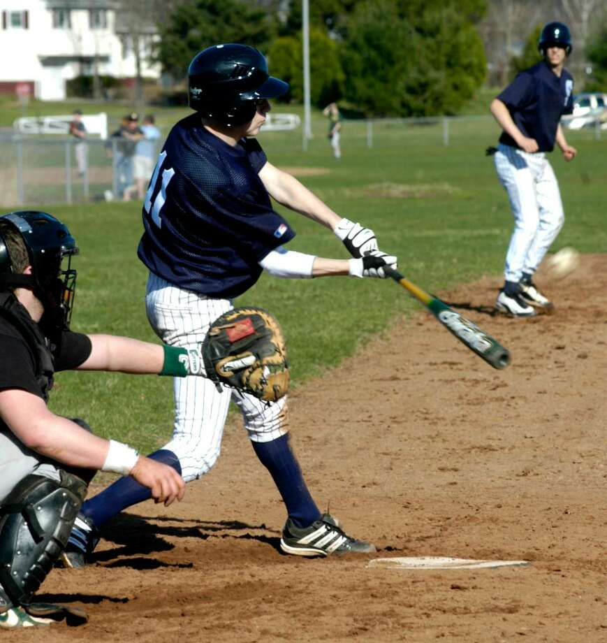 SPECTRUM/Shepaug Valley High School baseball #11 bats against New Milford as Adam Mennonna leads off third base during April 1, 2010 scrimmage at NMHS. Photo: Norm Cummings / The News-Times