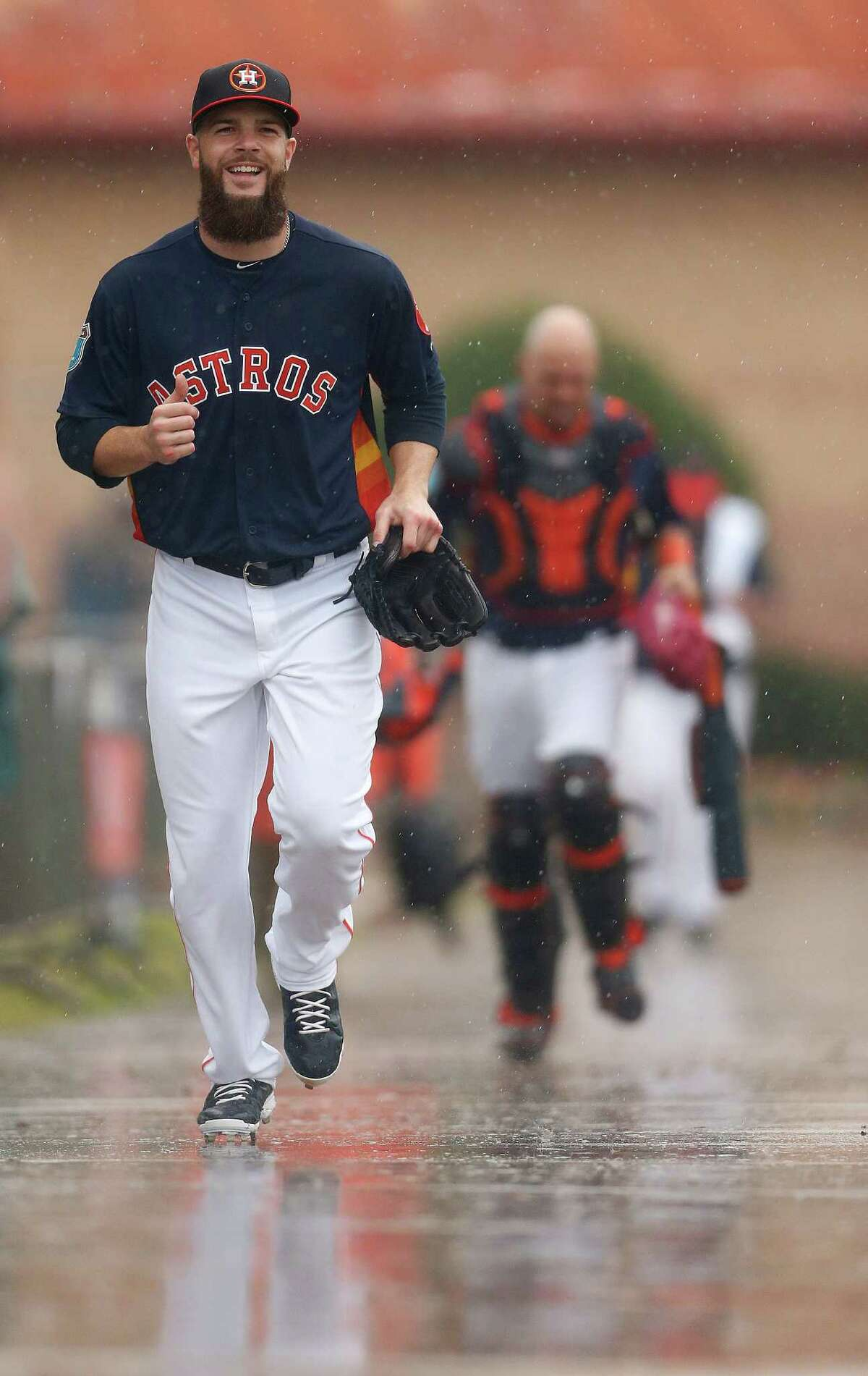 Houston Astros pitcher Dallas Keuchel runs to the batting cages as players worked out inside due to the rain during Astros spring training in Kissimmee, Florida, Wednesday, Feb. 24, 2016.