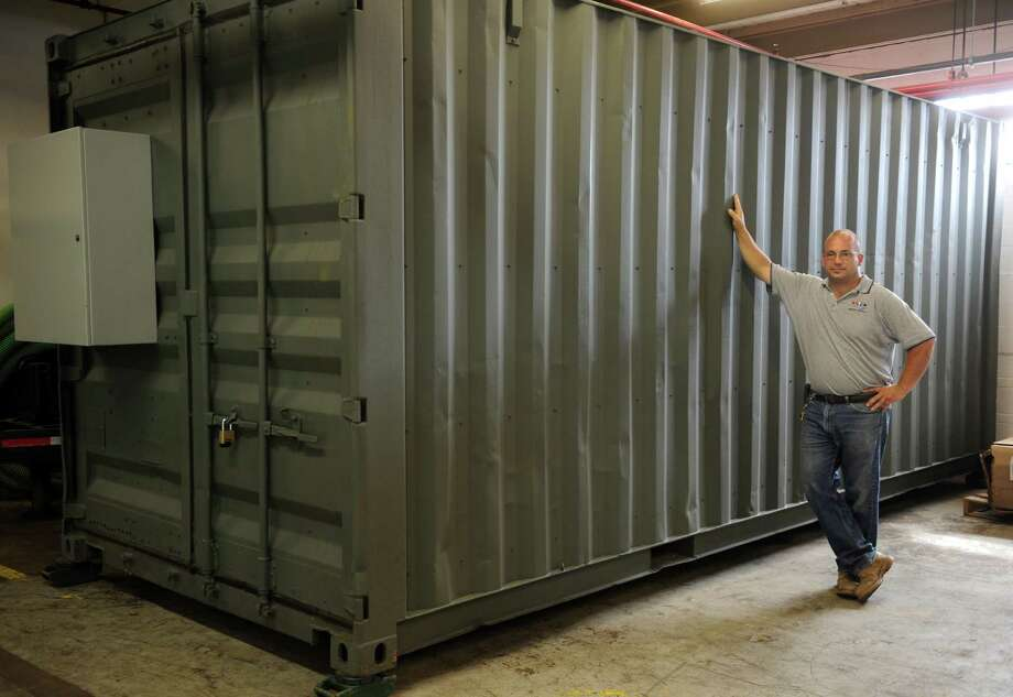 Shown here is Joseph Palmieri Jr., founder of Envirogrow, which specializes in indoor pot-growing equipment. Storage containers are being used by some for grow room operations. Photo: Autumn Driscoll / Autumn Driscoll / Connecticut Post
