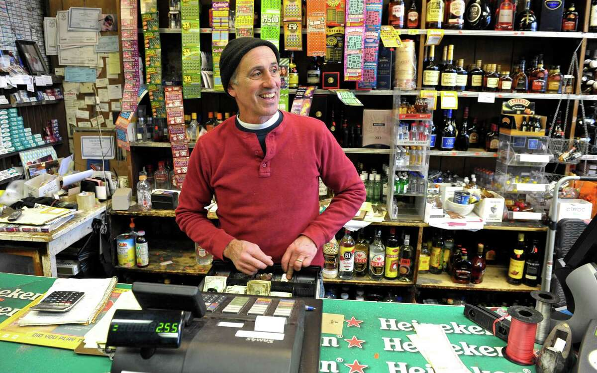 Maurice Samaga, owner of Danbury Wine & Liquor Store, on White Street, rings up a customer on Tuesday, February 23, 2016, in Danbury, Conn. The State of Connecticut is proposing to eliminate the state's minimum pricing law on alcohol..