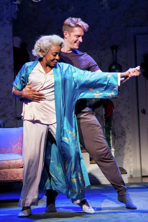 """Marjorie Johnson, left, as Dotty and Conlin Hanlon as Adam White in the play """"Dot"""" at the Vineyard Theater in New York, Feb. 3, 2016. The comedy-drama written by Colman Domingo follows Dotty and her failing mind as it becomes the focus of a fraught family gathering. (Sara Krulwich/The New York Times) ORG XMIT: XNYT199 Photo: SARA KRULWICH / NYTNS"""