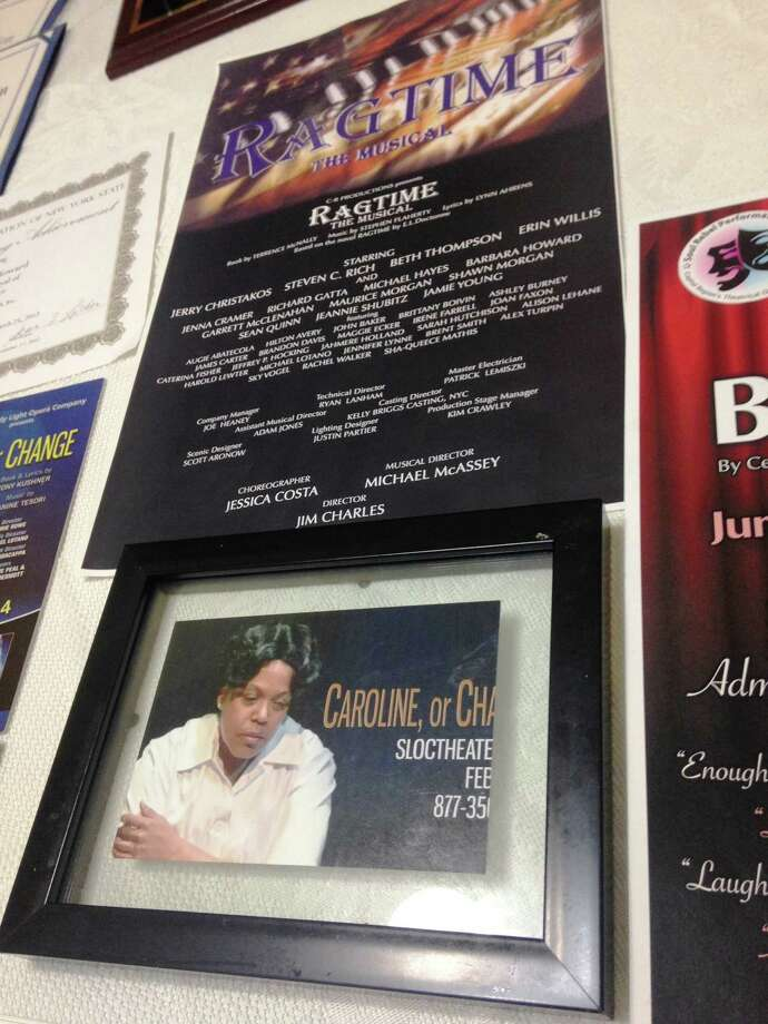 Posters displayed on a table at Barbara N. Howard's home. (Photo by Amy Biancolli)
