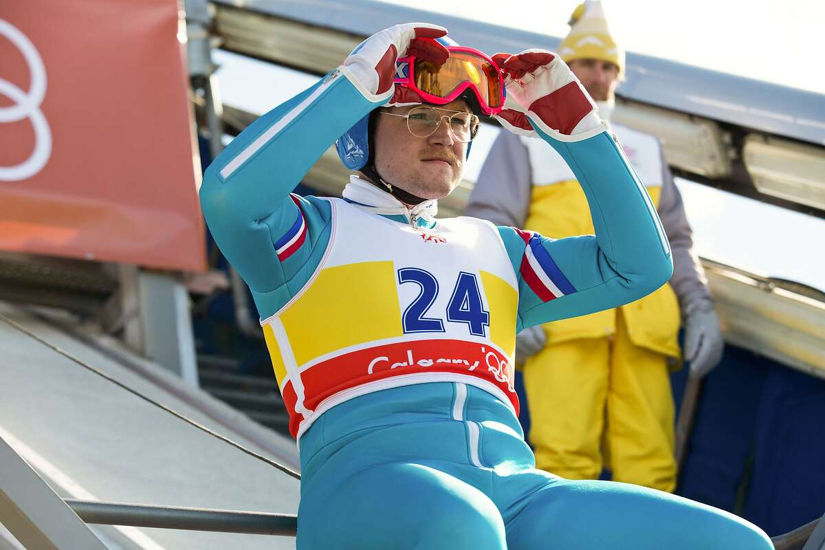 """""""Eddie the Eagle,"""" starring Taron Egerton and Hugh Jackman, opens on Friday. Check out the trailer."""