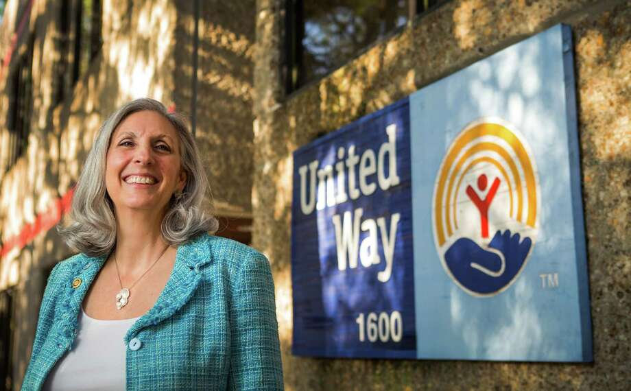 Julie Martineau said she will step down after 19 years as the president of the Montgomery County United Way after plans were announced Wednesday that the organization would merge with the United Way of Greater Houston in an effort to salvage dwindling funding. Photo: Brett Coomer, Staff / © 2014 Houston Chronicle