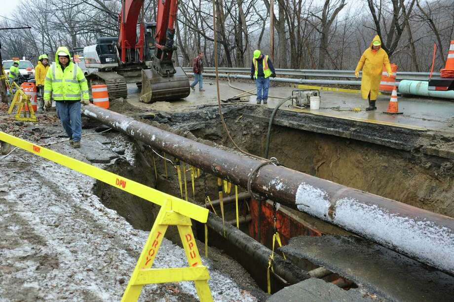 Troy Department of Public Utilities works to replace a sewer line in a sinkhole on Campbell Avenue on Wednesday, Feb. 24, 2016, in Troy, N.Y. (Cindy Schultz / Times Union) Photo: Cindy Schultz / Albany Times Union
