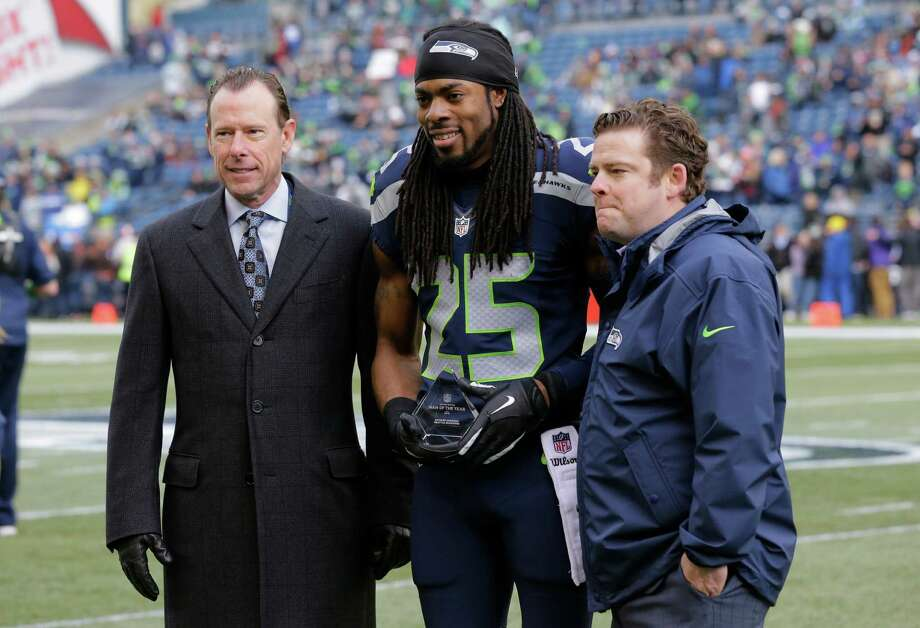 Seahawks general manager John Schneider (right) said he believed it was more likely than not that cornerback Richard Sherman stays with Seattle this season despite efforts to trade him. Check out the timeline surrounding Sherman's trade drama in the following gallery. Photo: Ted S. Warren, Associated Press / AP
