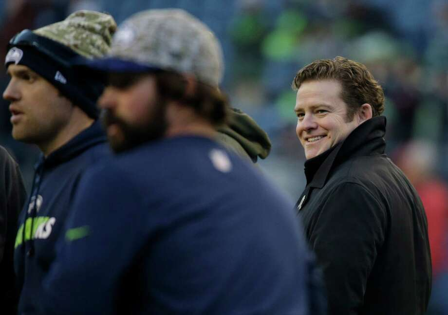 Seattle Seahawks general manager John Schneider, right, was the latest guest on Fox Sports' 'Peter Schrager Podcast,' discussing his career in NFL front offices. Photo: Elaine Thompson, Associated Press / AP