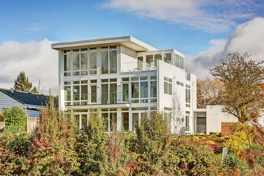 This home on Sunset Hill has a wall of windows facing west to capture Sound and mountain views. The full listing is here. Photo: Aimee Chase And Cully Ewing/Vista Estate Imaging