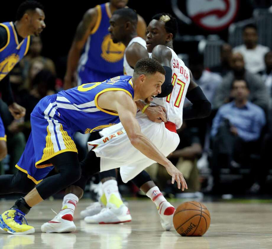 Golden State Warriors guard Stephen Curry (30) drives against Atlanta Hawks guard Dennis Schroder (17) in the first half of an NBA basketball game Monday, Feb. 22, 2016, in Atlanta. (AP Photo/John Bazemore)  ORG XMIT: GAJB103 Photo: John Bazemore / AP