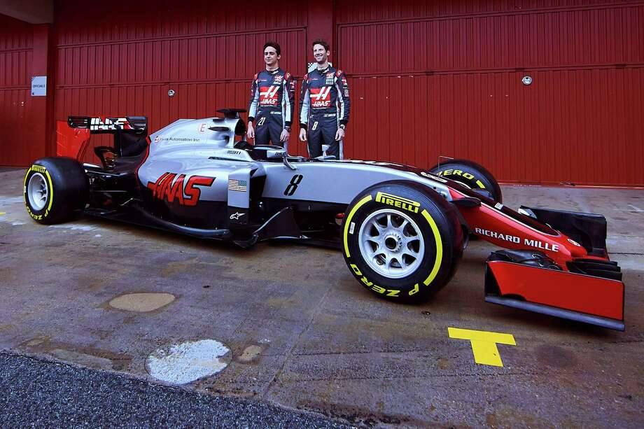New F1 Haas team drivers Esteban Gutierrez of Mexico, left, and Romain Grosjean of France pose during the official presentation of the new Ferrari-powered VF16 car at the Catalunya racetrack in Montmelo, just outside of Barcelona, Spain, Monday, Feb. 22, 2016. (AP Photo/Siu Wu) ORG XMIT: PW106 Photo: Siu Wu / AP