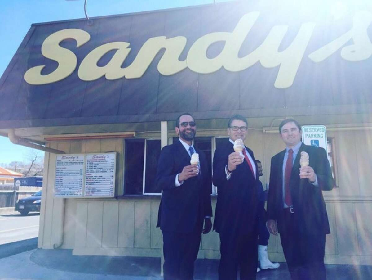Rick Perry (middle) visits Sandy's Hamburgers in Austin after an appeals court dismissed abuse-of-power charges against him on Feb. 24, 2016.