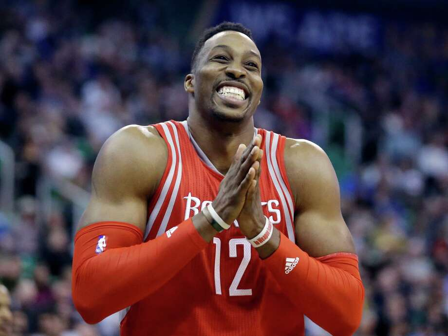 Dwight Howard has put on a happy face for the Rockets' stretch run. Photo: Rick Bowmer, STF / AP