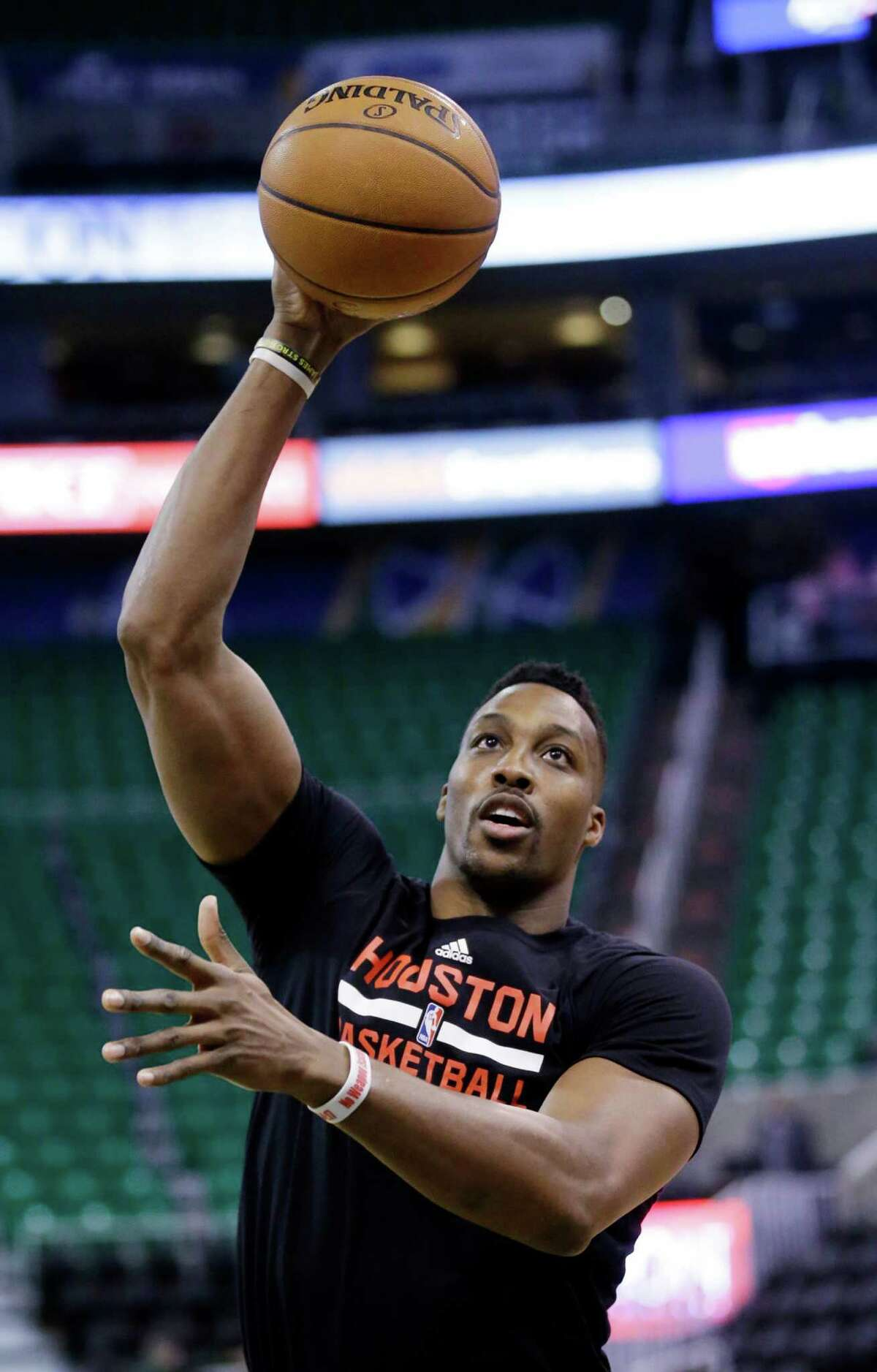 Houston Rockets center Dwight Howard shoots during practice before the start of their NBA basketball game against the Utah Jazz Tuesday, Feb. 23, 2016, in Salt Lake City. (AP Photo/Rick Bowmer)