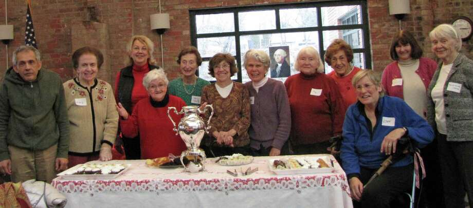 Greenwich Woman's Club recently sponsored the Fourth Silver Tea at River House in Cos Cob to celebrate and honor the residents. Residents and club members said they had a great time and had a chance to pose around the table featuring a silver tea set. Photo: Contributed / Contributed Photo / Greenwich Time Contributed