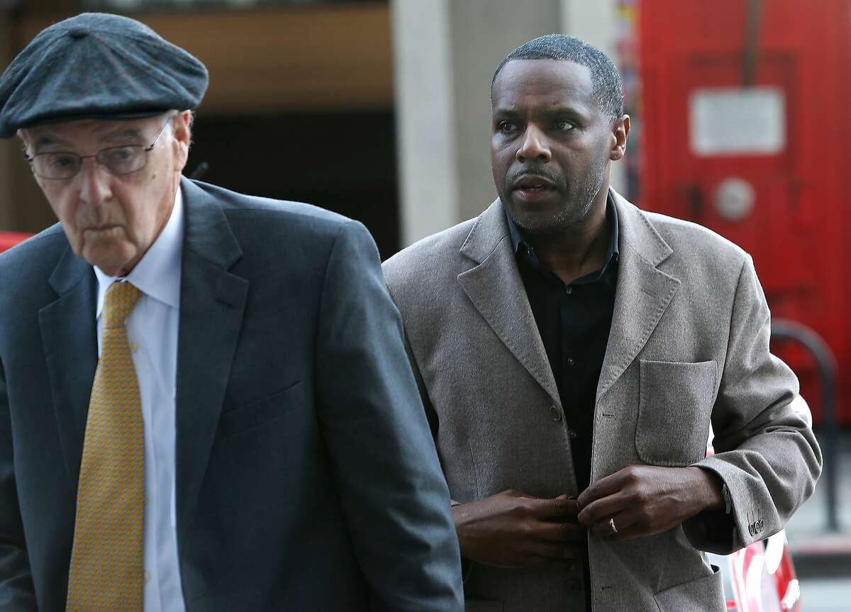 Former school board member Keith Jackson (right) arrives at the Phillip Burton Federal Courthouse for sentencing in a federal bribery and corruption case in San Francisco, Calif. on Wednesday, Feb. 24, 2016.