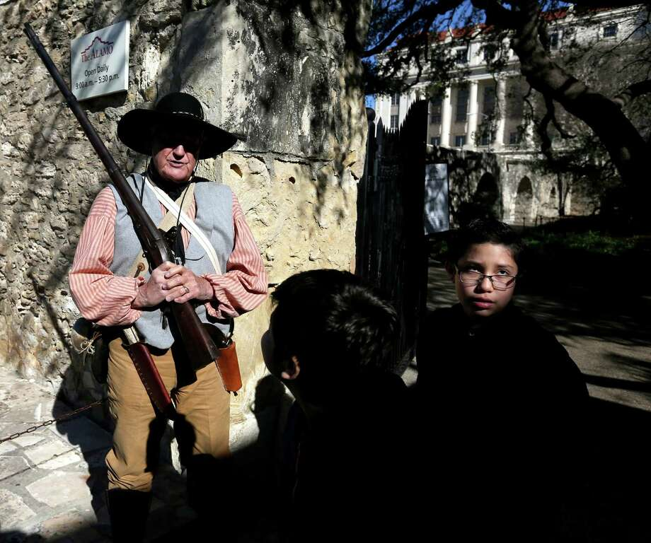 "Jeff Waldrop, dressed as an Alamo defender, greets children from Gregorio Esparza Elementary School Wednesday, Feb. 24, 2016, as they arrive at the Alamo to celebrate the 180th anniversary of William Travis' writing of his world famous ""Victory or Death"" letter. Gregorio Esparza was one of the Alamo defenders. Photo: William Luther, Staff / San Antonio Express-News / © 2016 San Antonio Express-News"