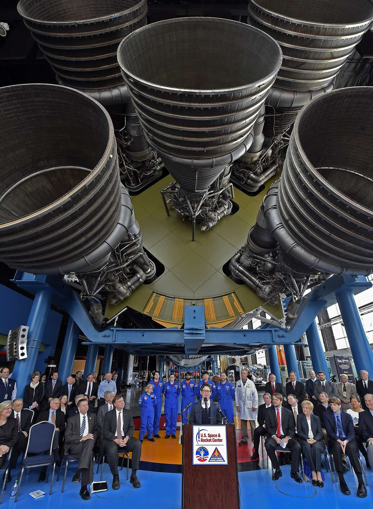 Jill Szuchmacher, director of Google Fiber Expansion, speaks at news conference under a Saturn V rocket at the Davidson Center at the U.S. Space & Rocket Center on Monday, Feb. 22, 2016, announcing that Huntsville Utilities and Google will build a fiber network to bring high speed TV and Internet service to the city's residents and businesses. (Bob Gathany/AL.com via AP)